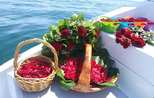 Roses ready for burial at Sea